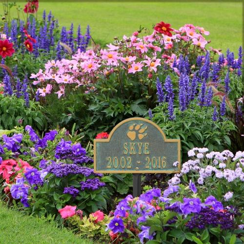 Bronze Verdigris Dog Paw Arch Lawn Memorial Marker in the Garden