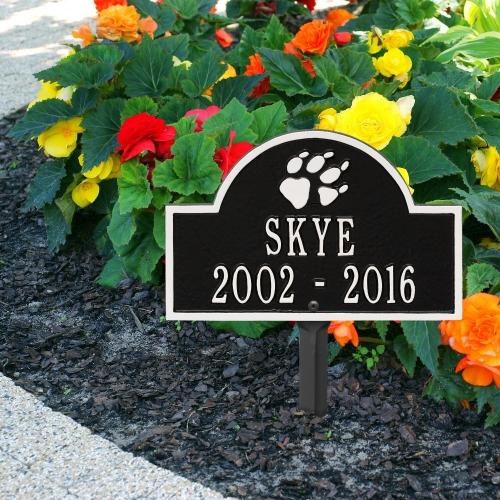 Black & White Dog Paw Arch Lawn Memorial Marker on the Sidewalk