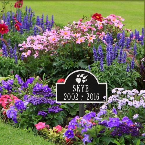 Black & White Dog Paw Arch Lawn Memorial Marker in the Garden