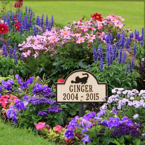 Limestone & Dark Bronze Dog Paw Arch Lawn Memorial Marker  in the  Colorful Vibrant Garden