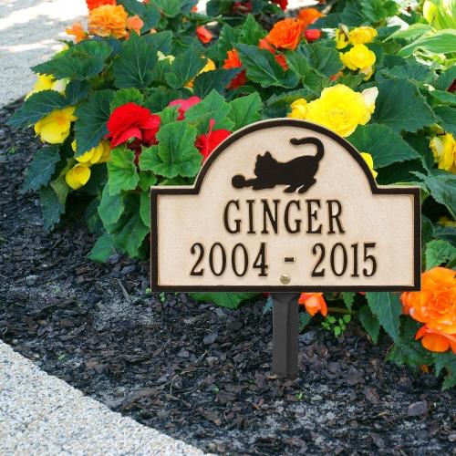 Limestone & Dark Bronze Dog Paw Arch Lawn Memorial Marker on a Beautiful Planted Sidewalk